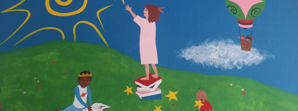 Mural of children playing with stars by Rachel Klos