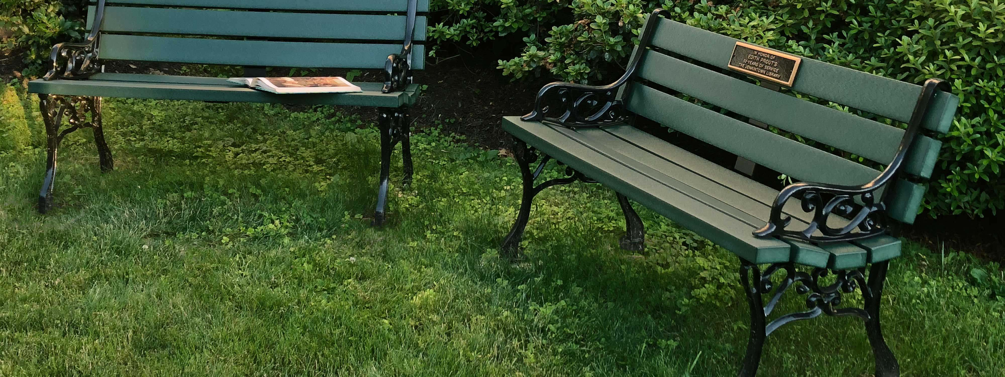 two benches in grass