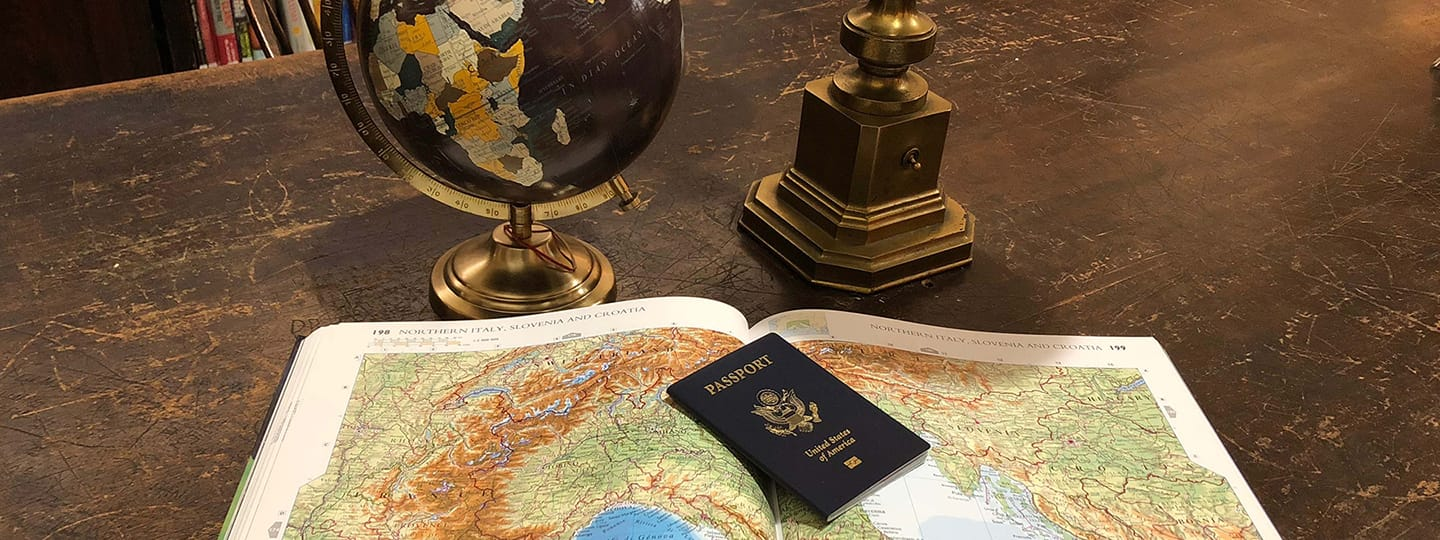a passport on an atlas