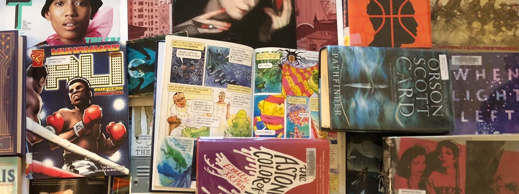 a collage of books, graphic novels, and magazines