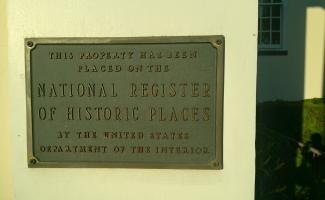 "A plaque designating that ""This property has been placed on the National Register of Historic Places by the US Dept. of the Interior"""