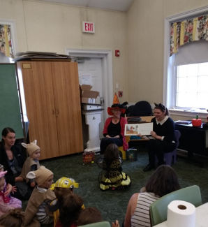 Miss Maureen and Miss Doris read The Little Old Lady Who Was Not Afraid of Anything to a group of children
